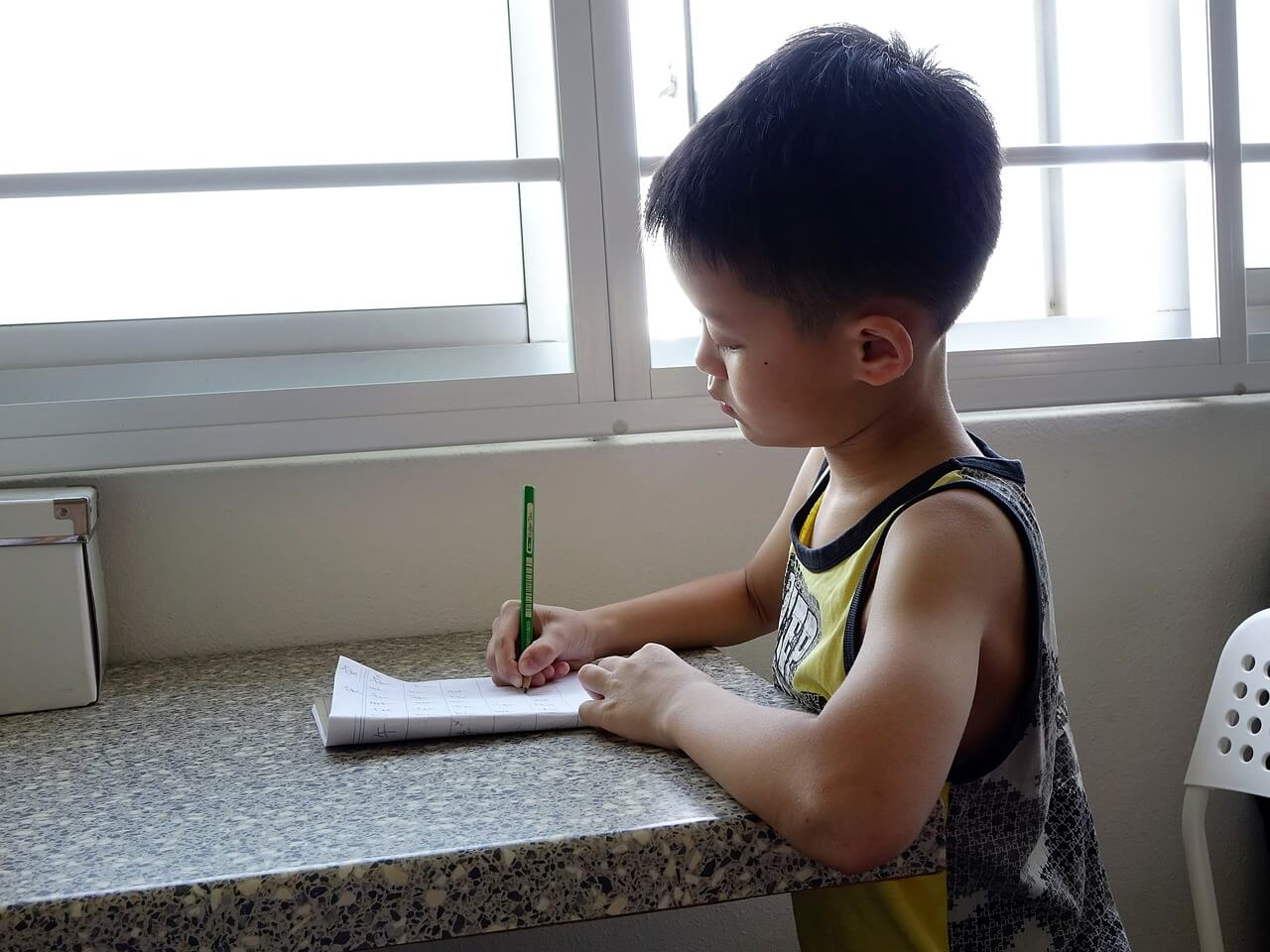 child studying in room